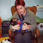 Susan Blackmore and Baby Chimp at Sally Boysen's lab, Ohio, Feb 2001
