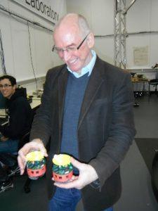 Alan Winfield with two of his robots at the Bristol Robotics Lab