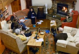 Discussions round the fire – see the attempts at Chinese junks scattered around the room.